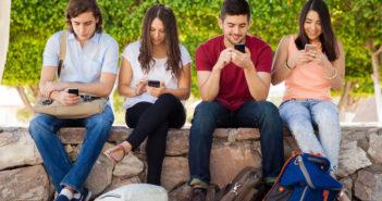 Kids teens with smartphones 2